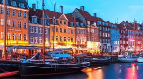 The restaurants and boats in Nyhavn, Copenhagen on a summer night