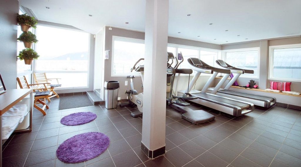 Modern gym with a view at Aurora Hotel in Tromso