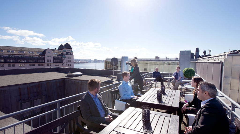 Outside area with large terrace and a stunning view at Bastion Hotel in Oslo