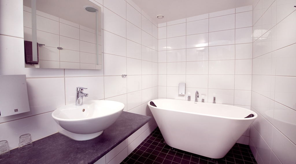 Suite with large bathroom and bathtub at Bilan Hotel in Karlstad