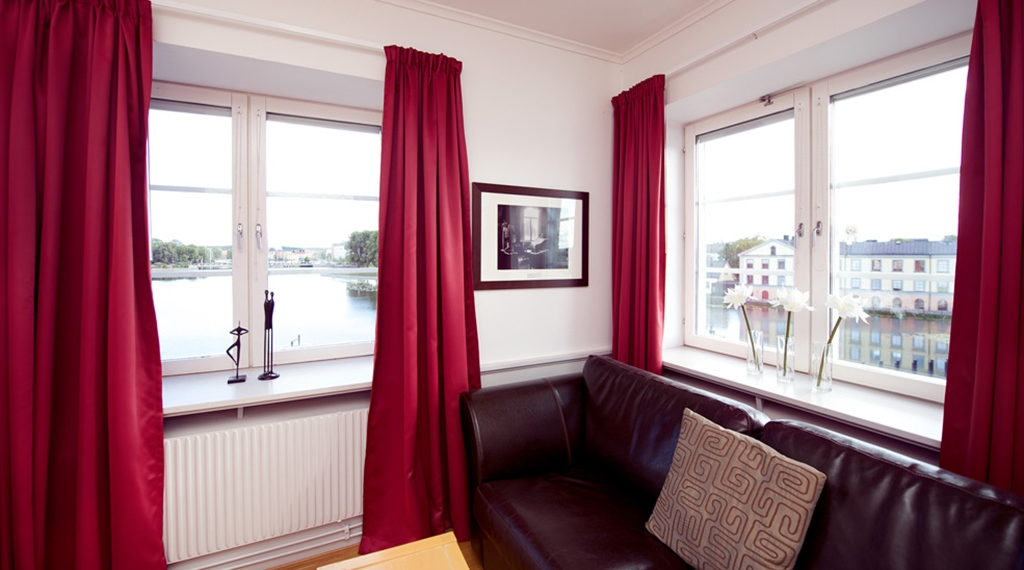 Bright family room with lake view at Bolinder Munktell Hotel in Eskilstuna