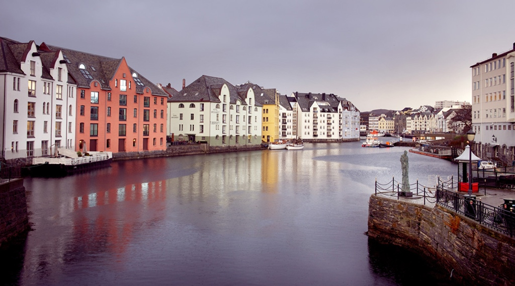 The beautiful facade of the Bryggen Hotel in Alesund by the water