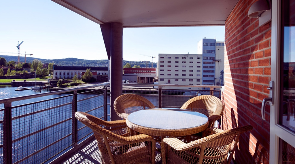 Outside area including a balcony with amazing view of he canal at Bryggeparken Hotel in Skien