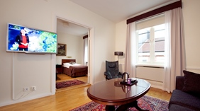 Spacious deluxe double room with living room at Cardinal Hotel in Vaxjo