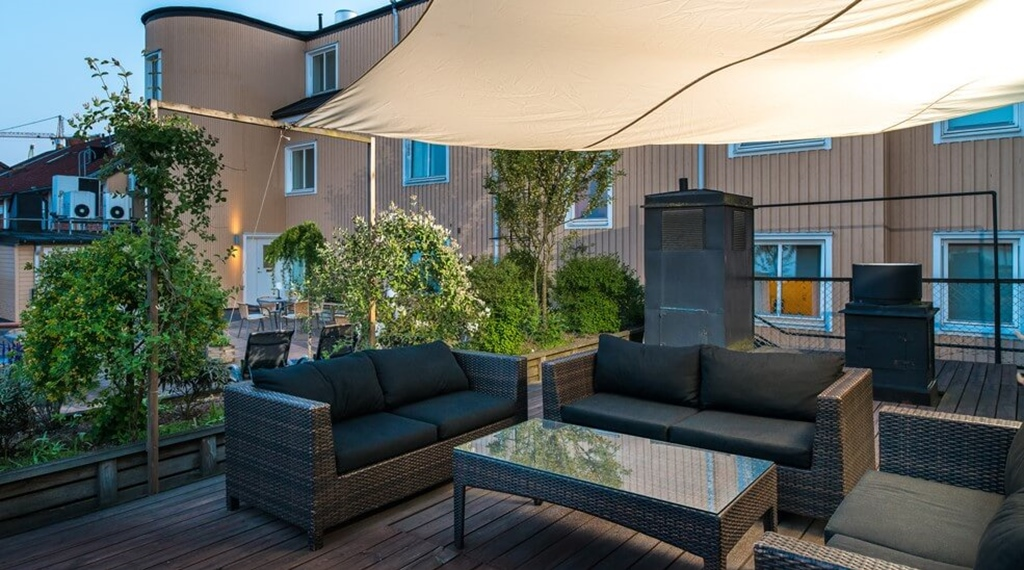Outside terrace with seating area and roof cover at Clarion Collection Hotel Cardinal Vaxjo