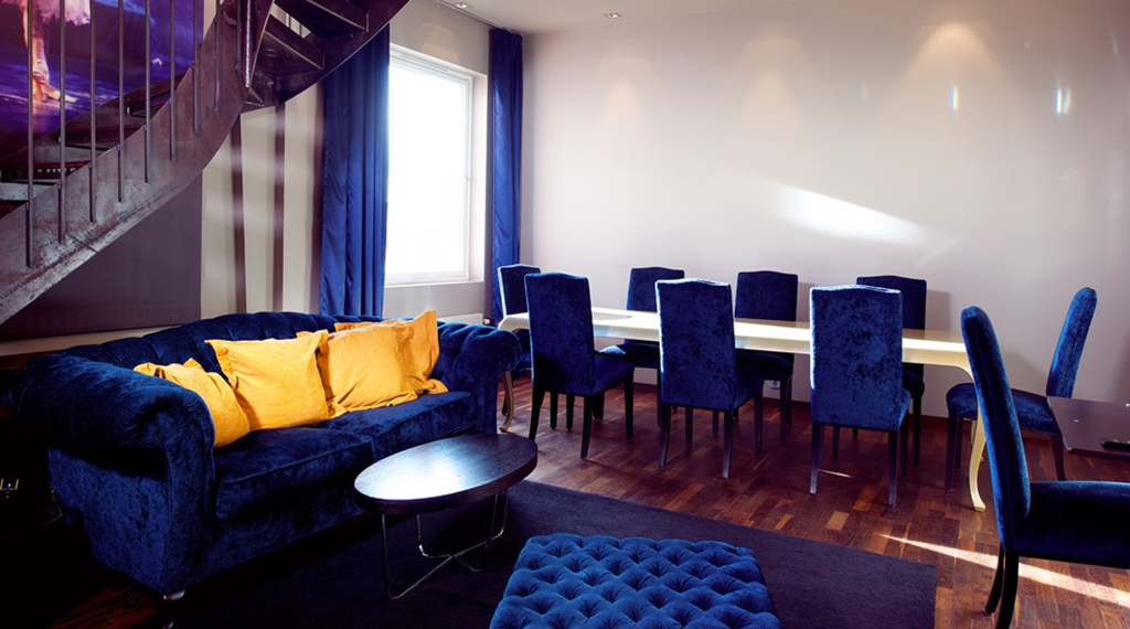 Suite with living room and large dining room at Folketeateret Hotel in Oslo