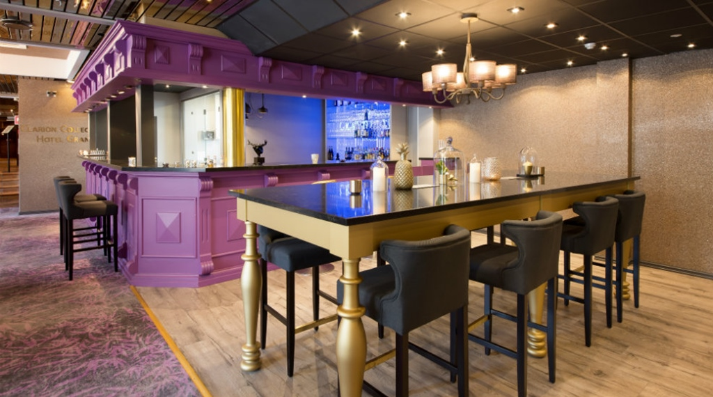Bar table and chairs in the lobby at Clarion Collection Hotel Grand Gjøvik in Norway