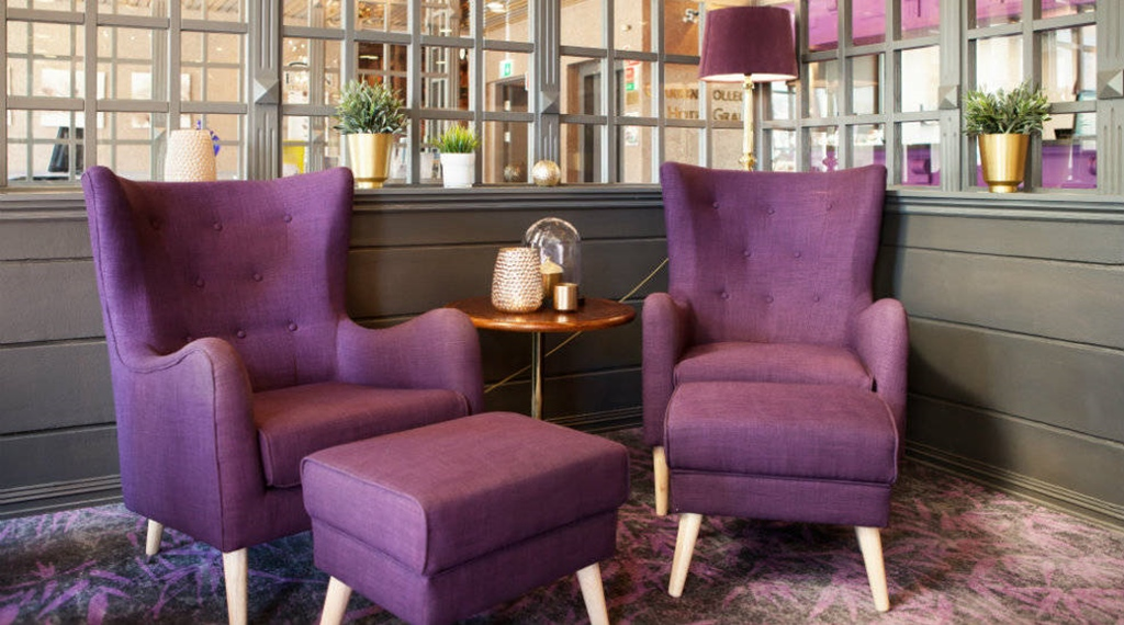 Purple chairs in the lobby of Clarion Collection Hotel Grand Gjøvik in Norway