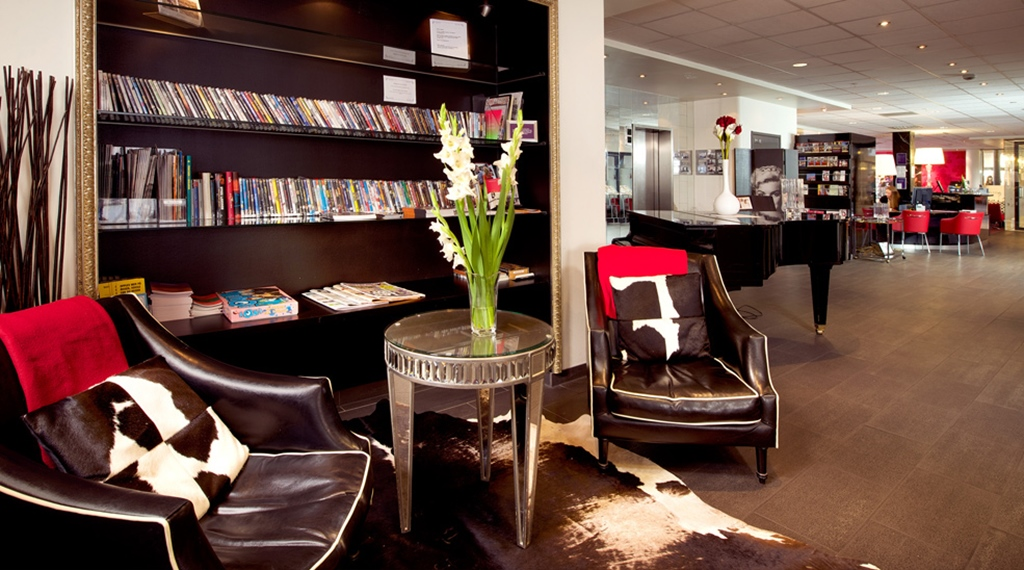 Comfortable lobby area with magazines and music at Grand Olav Hotel in Trondheim