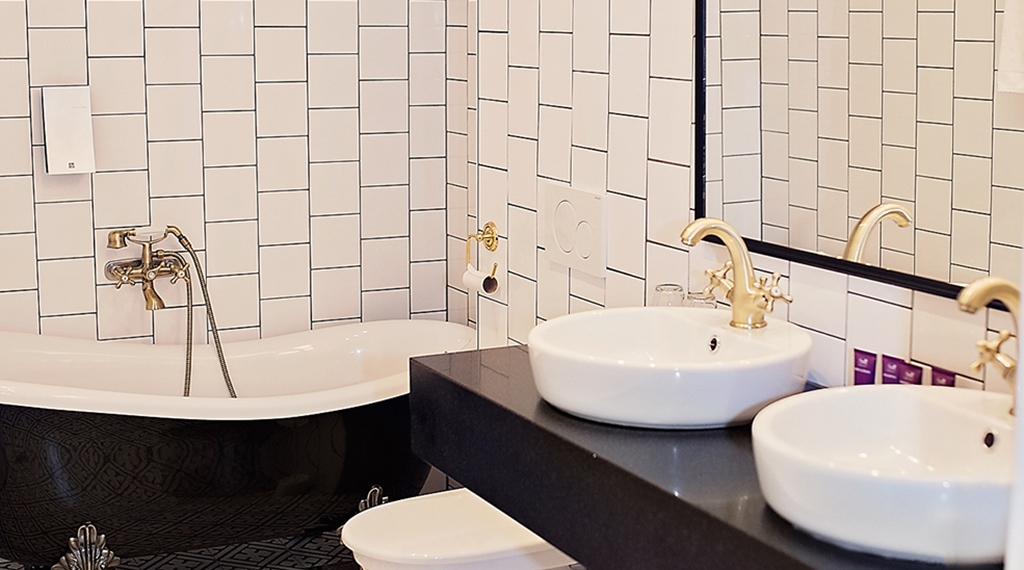Large stylish bathroom in suite at Grand Sundsvall Hotel in Sundsvall