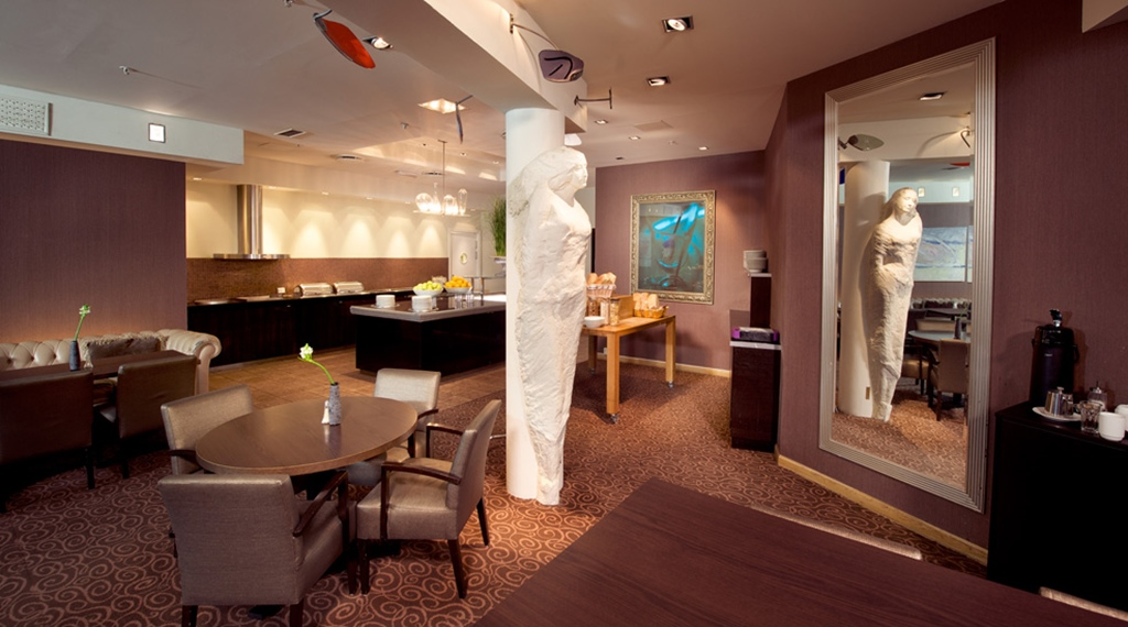 Trendy dining area with large buffet at Havnekontoret Hotel in Bergen