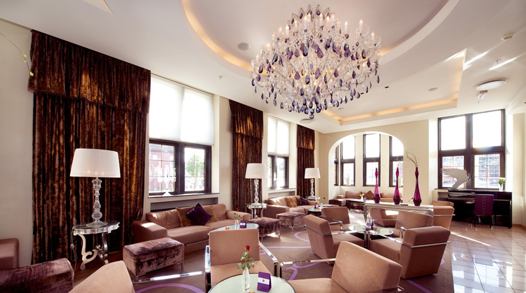 Spacious and elegant lobby area with a view at Havnekontoret Hotel in Bergen