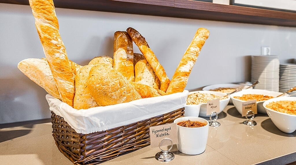 Breakfast buffet with freshly made bread at Helma Hotel in Mo i Rana