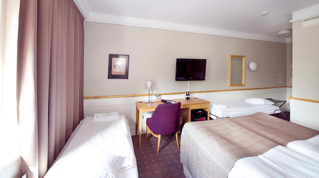 Well-furnished family room at Kompaniet Hotel in Nykoping