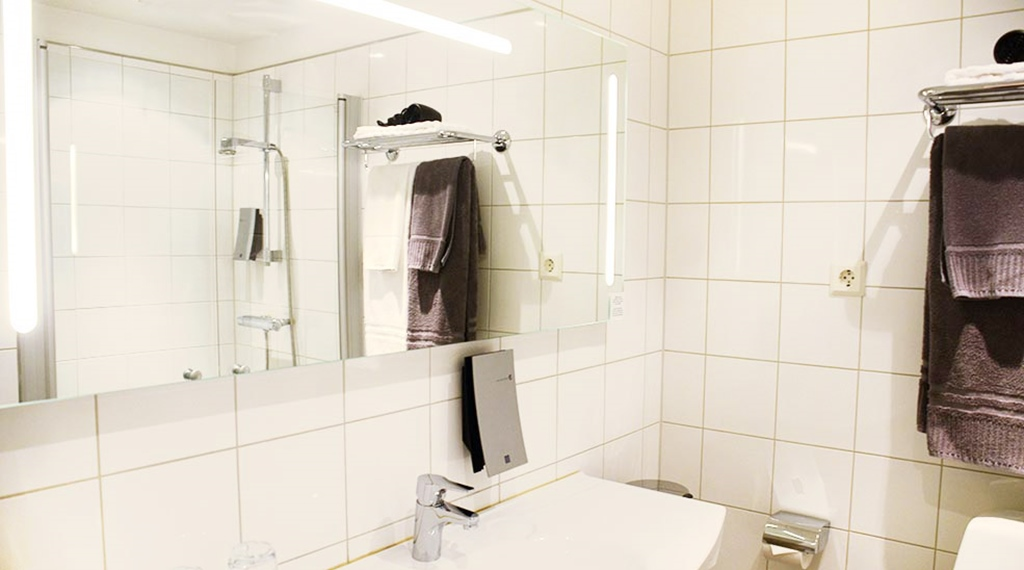 Overview bathroom standard room with shower at Clarion Collection Hotel Kompaniet Nyköping