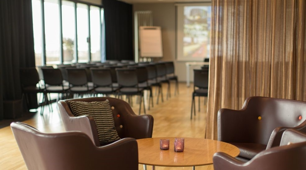 Leather chairs in meeting room with terrace at Clarion Collection Hotel Odin in Gothenburg