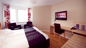 Elegant and well-furnished standard double room at Odin Hotel in Gothenburg