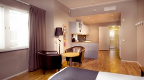 Stylish superior twin room with kitchen facilities at Odin Hotel in Gothenburg