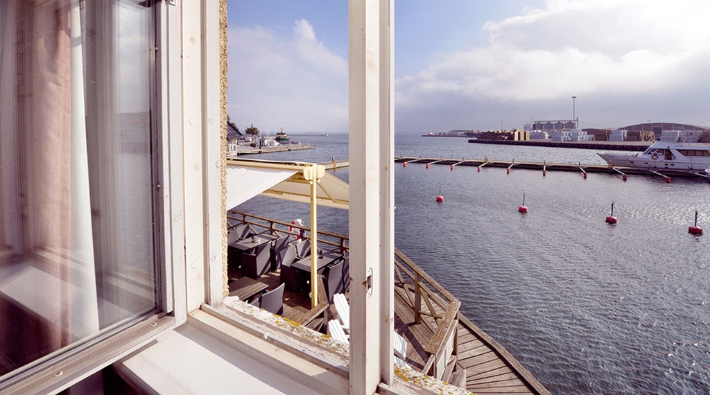 Hotel room with a great view of Kalmar harbour and the ocean at Packhuset Hotel in Kalmar