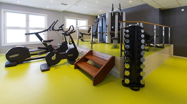 Well-equipped gym with modern fitness machines at Plaza Hotel in Karlstad