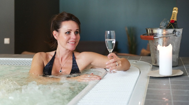Enjoying the romantic hot tub area and some champagne at Plaza Hotel in Karlstad