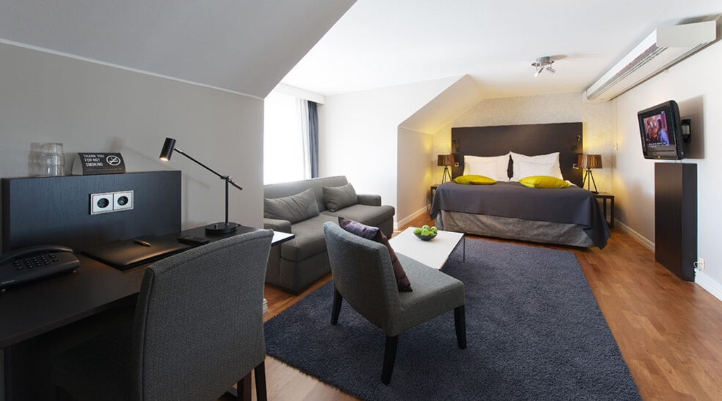 Extensive and well-furnished deluxe hotel room at Plaza Hotel in Karlstad