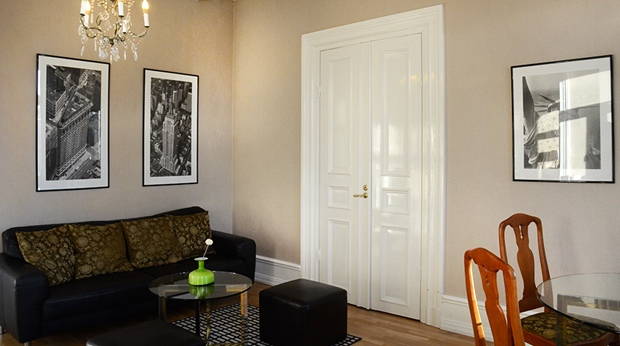 Spacious and well-furnished suite living room at Plaza Hotel in Karlstad
