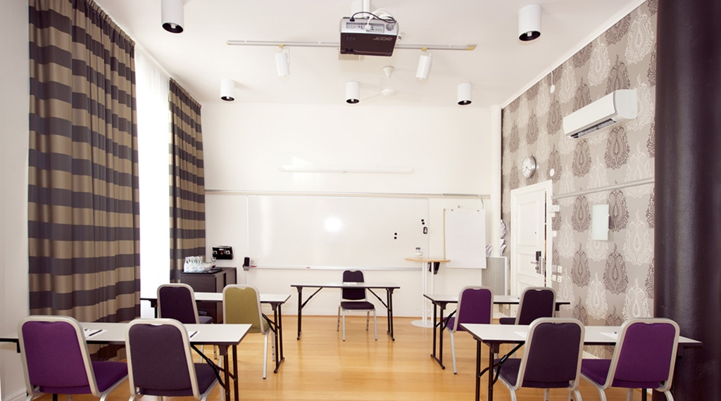 Spacious and bright meeting room with a projector at Post Hotel in Oskarshamn
