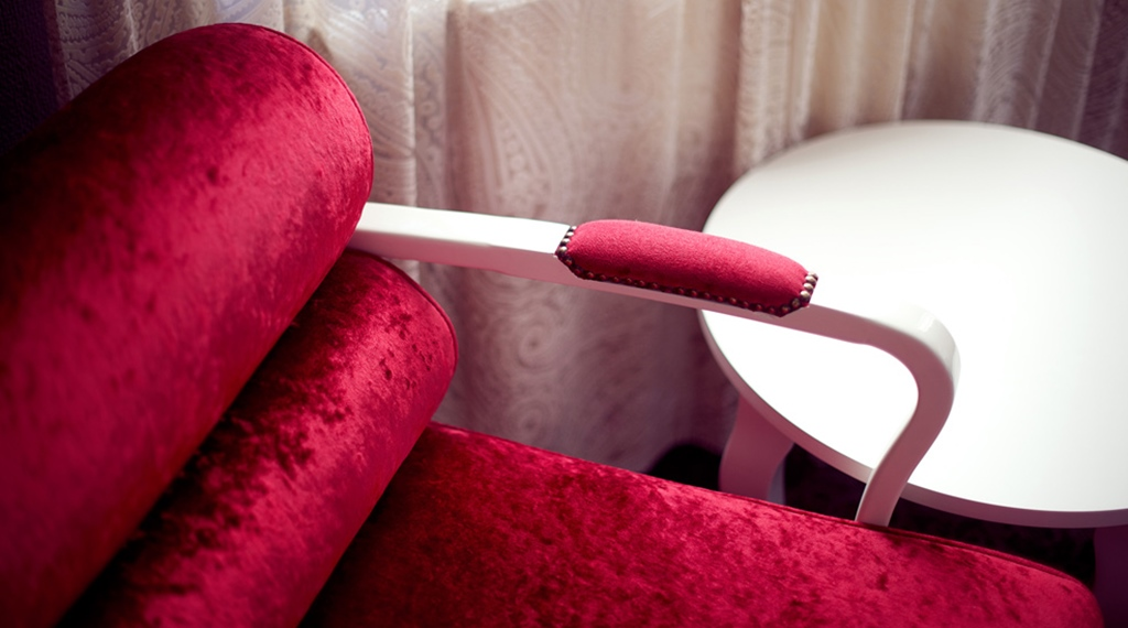 Interior design including a colourful designer chair at Savoy Hotel in Oslo