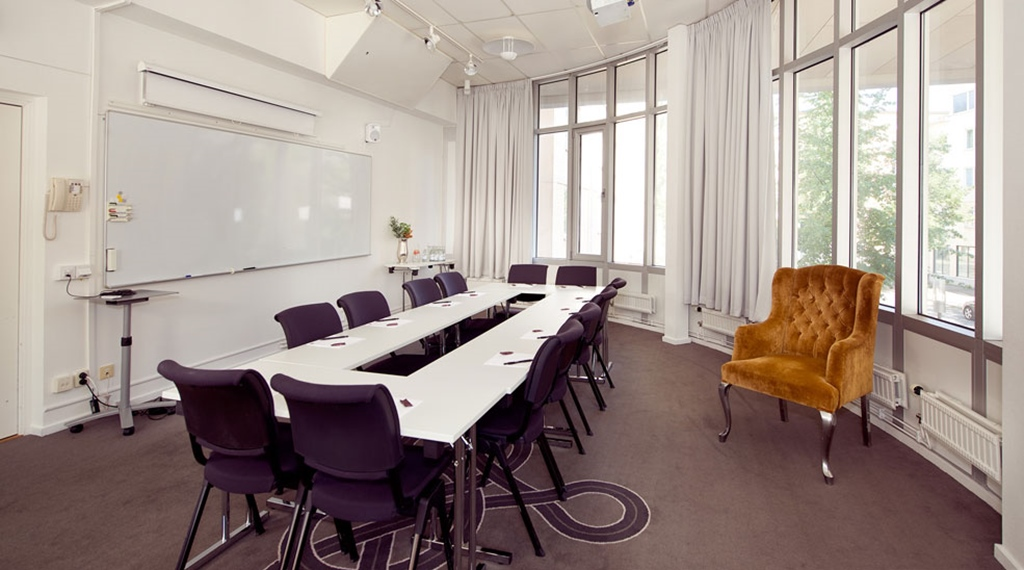 Modern conference room with large windows at Tapto Hotel Stockholm
