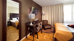 Bright standard double room with quality furniture at Tapto Hotel Stockholm