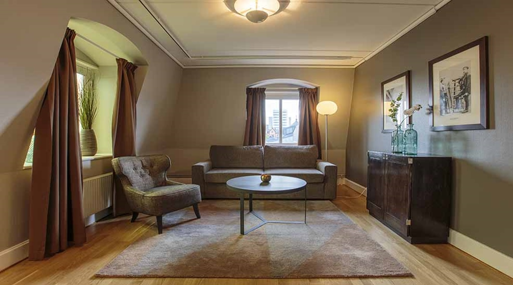 abd66ba2616 Suite living room with sofa and chair at Clarion Collection Hotel Uman Umeå