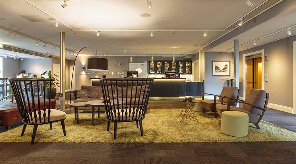 44f9d6ecf39 Lobby with a reception and seating area at Clarion Collection Hotel Uman  Umeå