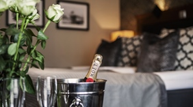 Hotel room details including flowers and champagne at Grand Hotel Helsingborg