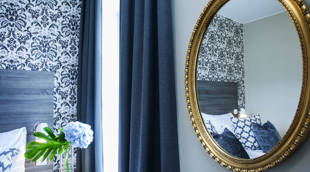 Stylish interior design including a beautiful mirror at Grand Hotel Helsingborg