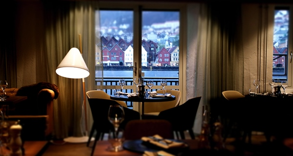 Cosy restaurant area with an astonishing view of the inlet and mountains at Admiral Hotel in Bergen
