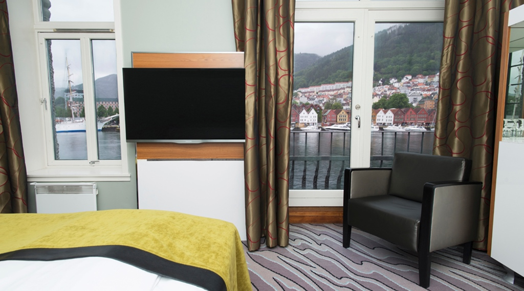 Chic hotel room directly by the harbour and with a view of the inlet and mountains at Admiral Hotel in Bergen