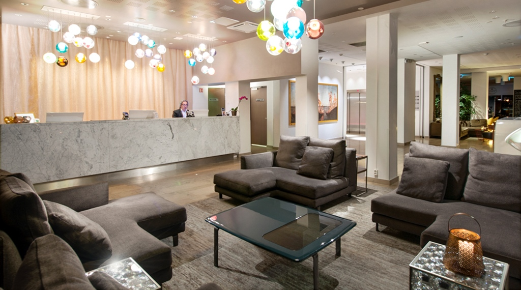 Fashionable lobby with comfortable furniture at Admiral Hotel in Bergen