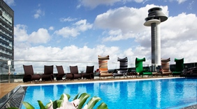 Large pool and spacious outside pool area at Arlanda Hotel in Stockholm