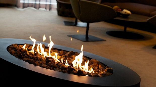 The interior details includes a stylish open fire place at Arlanda Hotel in Stockholm