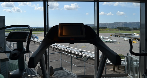 Modern gym with a great view of Bergen airport at Bergen Airport Hotel in Bergen