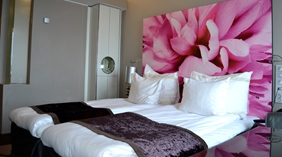 Spacious and colourful superior twin hotel room at Bergen Airport Hotel in Bergen