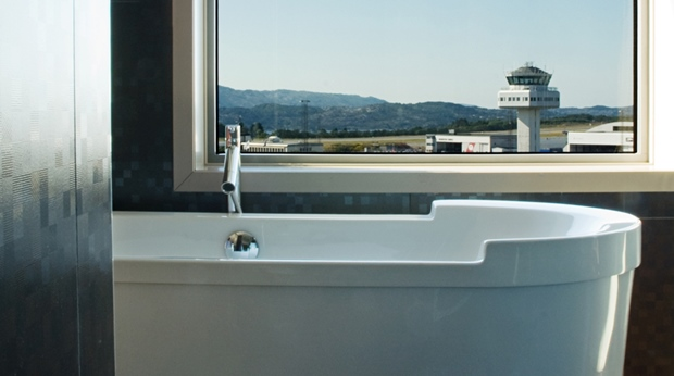 Enjoy the view of the airport from the bathtub in the suite at Bergen Airport Hotel in Bergen