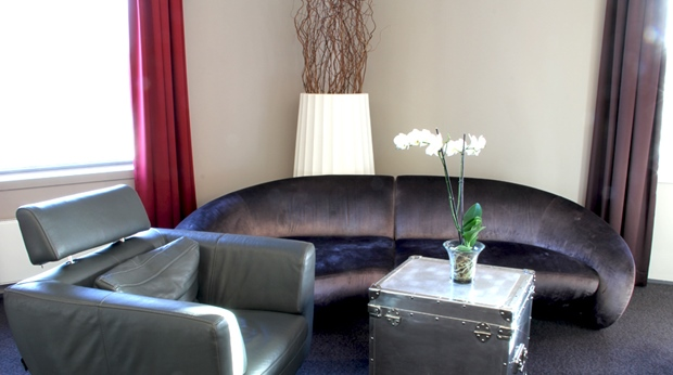 Stylish and comfortable living room in the junior suite at Bergen Airport Hotel in Bergen