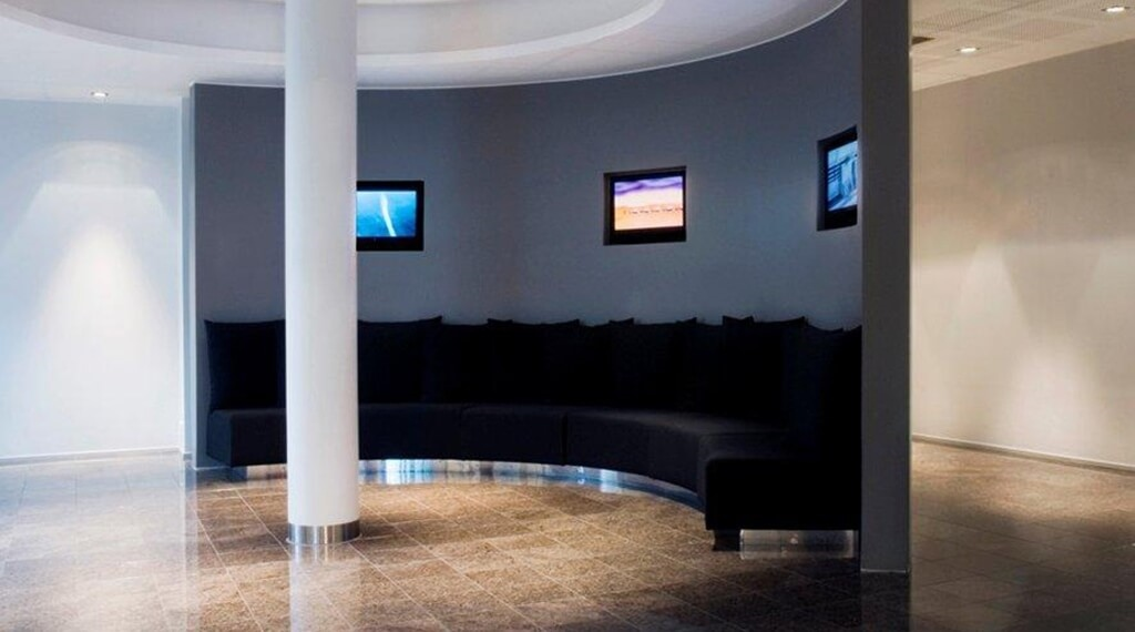 Large common area with comfortable furniture at Bergen Airport Hotel in Bergen