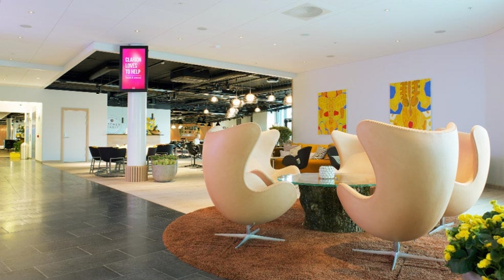 Stylish lobby area with Arne Jacobsen designer chairs at Energy Hotel in Stavanger