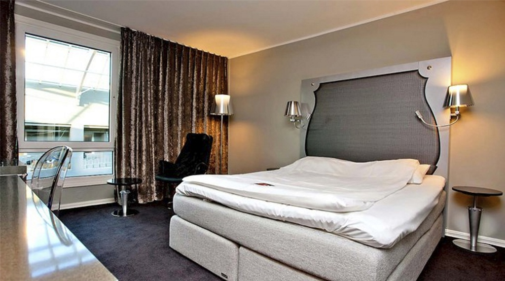 Large and well-equipped standard hotel room at Ernst Hotel in Kristiansand