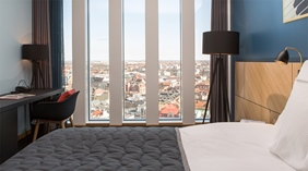 Elegant standard twin hotel room with the perfect view of the city at Malmo Live Hotel in Malmo
