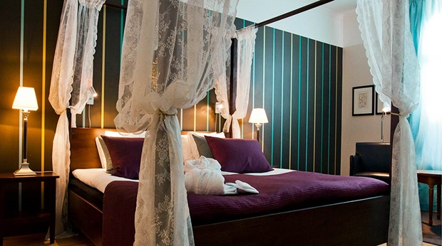 Colourful and elegant deluxe hotel room at Hotel Orebro