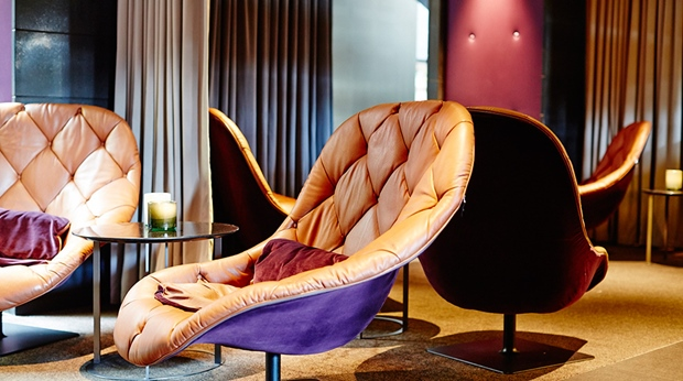 Stylish bar lounge area characterised by stylish designer chairs at Post Hotel in Gothenburg